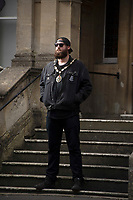 BNPS.co.uk (01202) 558833<br /> Pic: ZacharyCulpin/BNPS<br /> <br /> Pictured: Punk rock Mayor Andy in front of Frome Town Hall<br /> <br /> At 6ft 9in tall, dressed all in black, with a big beard and wearing wayfarer shades, Andy Wrintmore does not look like your typical mayor.<br /> <br /> But the 29-year-old hardcore punk rock drummer is a big hit with old and young constituents in his hometown of Frome, Somerset.<br /> <br /> Andy, a member of punk band SickOnes, was elected to the town council by a landslide vote in 2019 and chosen to become the town's mayor in May this year.<br /> <br /> He has earned the moniker the 'punk rock mayor of Frome' and has even been interviewed by Kerrang magazine about his new career - cutting ribbons and meeting local community groups.