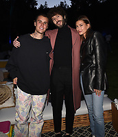 """LOS ANGELES, CA - JUNE 10: (L-R) Justin Bieber, Dave Burd, and Hailey Bieber attend the Season Two Red Carpet event for FXX's """"DAVE"""" at the Greek Theater on June 10, 2021 in Los Angeles, California. (Photo by Frank Micelotta/FXX/PictureGroup)"""
