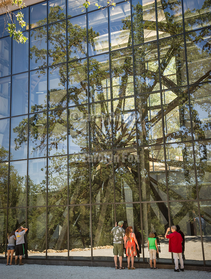 A new metal and glass building protects the Kennedy Tailing Wheel No. 4 unveiled at the dedication of the new structure and refurbishment of the Kennedy Tailing Wheels Park, Jackson, California.