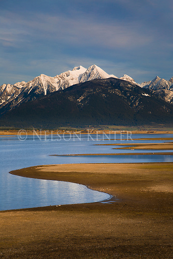 Low water level at Ninepipe Reservoir in western Montana with the Mission Mountains