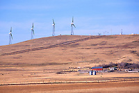 Wind Turbines generating Renewable Wind Energy Power on Farmland / Ranchland - Industry near Pincher Creek, Southern Alberta (AB), Canada, Canadian Rocky Mountain Foothills