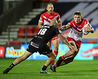20th November 2020; Totally Wicked Stadium, Saint Helens, Merseyside, England; BetFred Super League Playoff Rugby, Saint Helens Saints v Catalan Dragons; Jack Welsby of St Helens fends off a tackle from Alrix da Costa of Catalan Dragons