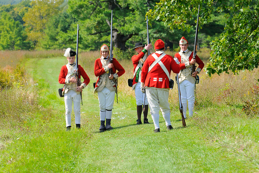 Soldiers of His Majesty's 62nd Regiment of Foot on exercises at a Revolutionary War encampment at Freeman's Farm, site of a major British defeat in September 1777, Saratoga National Historical Park, Stillwater, New York, USA.