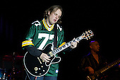 Joe Bonamassa plays the blues at the Oneida Casino in Green Bay Wisconsin on  11/5/07 doing an encore with a Green Bay Packers jersey.