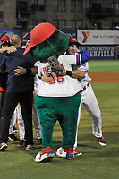 Mascot Reedy Rip'It and Mitchell Gunsolus of the Greenville Drive celebrate their 2017 South Atlantic League Championship following an 8-3 win over the Kannapolis Intimidators in Game 4 of the Championship Series on Friday, September 15, 2017, at Fluor Field at the West End in Greenville, South Carolina. It was Greenville's first SAL Championship. Greenville won the series 3-1. (Tom Priddy/Four Seam Images)