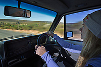Shauna Coxsey drives an old VW Beetle after a days climbing, Rocklands, South Africa