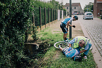 """Tyler Williams (USA/Israel Cycling Academy) & his teammate Ben Perry (CAN/Israel Cycling Academy) crashed into a no-parking sign and Williams was left lying down in what looked to be a serious crash. Fortunately all turned out pretty ok as he apperently just sustained some serious bruises.<br /> <br /> Antwerp Port Epic 2018 (formerly """"Schaal Sels"""")<br /> One Day Race:  Antwerp > Antwerp (207 km; of which 32km are cobbles & 30km is gravel/off-road!)"""
