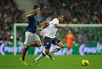 Olivier Giroud of France and Danny Williams of team USA fight for the ball during the friendly match France against USA at the Stade de France in Paris, France on November 11th, 2011.