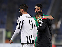 Calcio, Serie A: Lazio vs Juventus. Roma, stadio Olimpico, 4 dicembre 2015.<br /> Juventus' players, from left, Alvaro Morata, Gianluigi Buffon and Paulo Dybala celebrate at the end of the Italian Serie A football match between Lazio and Juventus at Rome's Olympic stadium, 4 December 2015. Juventus won 2-0.<br /> UPDATE IMAGES PRESS/Isabella Bonotto