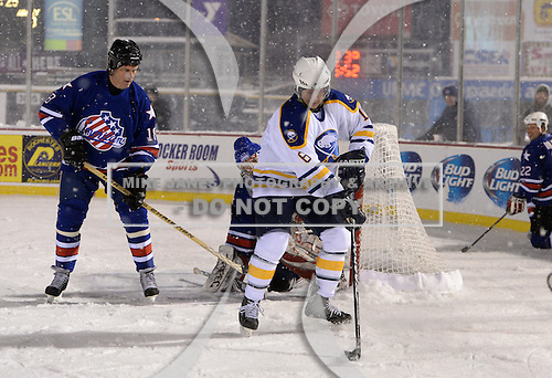 Ric Seiling (16) controls the puck in front of goalie Tom Askey (35) and Jim Wiemer (18) during The Frozen Frontier Buffalo Sabres vs. Rochester Amerks Alumni Game at Frontier Field on December 15, 2013 in Rochester, New York.  (Copyright Mike Janes Photography)