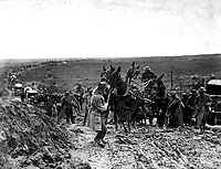 Private Shook trying to move mules hauling an American ammunition wagon stuck in the road, holding up the advance of the whole column.  St. Baussant, east of St. Mihiel, France, September 13, 1918.  Sgt. J. A. Marshall.   (Army)<br /> NARA FILE #:  111-SC-20902<br /> WAR & CONFLICT BOOK #:  585