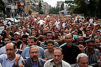 Beirut, Lebanon, Aug 9 2006.Shiyah neighbourhood, Makhbar e Shahideen cemetery, the funeral of the 39 civilians, many of them women and children, killed on August 7th, when Israeli bombs levelled an appartment building in this non-Hezbollah suburb of Beirut, without any apparent reason.