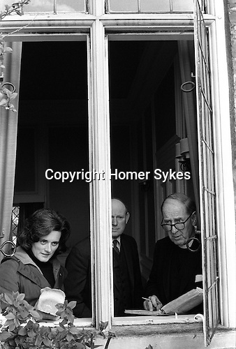Dame Elizabeth Marvyn Charity. Ufton Court, Near Ufton Nervet, Berkshire, England 1974.<br /> <br /> Mrs Ann Benyon distributing the dole. Local farmer George Hayes, who was a Trustees of the charity, and the Revd Arthur Burrell with the register calling out the names of recipients of the dole.