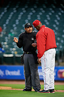 Louisville Bats manager Delino DeShields (90) questions a call with umpire Robert Moreno during a game against the Columbus Clippers on May 1, 2017 at Louisville Slugger Field in Louisville, Kentucky.  Columbus defeated Louisville 6-1  (Mike Janes/Four Seam Images)