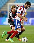 Atletico de Madrid's Raul Garcia (r) and Bayer 04 Leverkusen's Simon Rolfes during Champions League 2014/2015 match.March 16,2015. (ALTERPHOTOS/Acero)