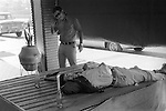 Mazatlan Mexico 1973. Sleeping official lunch time siesta. He is drunk, friends have put the two candles on either side of his head as a joke.