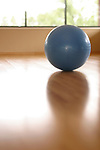 large inflated excersize ball commonly used in Pilates workout on floor of health club