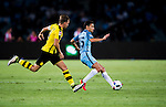 Manchester City midfielder Jesus Navas (r) fights for the ball with Borussia Dortmund captain Marcel Schmelzer (l) during the match between Manchester City FC during their 2016 International Champions Cup China match at the Shenzhen Stadium on 28 July 2016 in Shenzhen, China. Photo by Marcio Machado / Power Sport Images