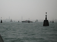 Boat's on Venice's lagoon with San Marco in the distance