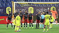 NASHVILLE, TN - SEPTEMBER 23: Yamil Asad #11 of DC United argues the placement of the ball with referee Tori Penso during a game between D.C. United and Nashville SC at Nissan Stadium on September 23, 2020 in Nashville, Tennessee.