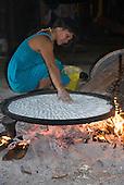Xingu Indigenous Park, Mato Grosso State, Brazil. Aldeia Tanguro (Kalapalo); Isabel making beju manioc bread.