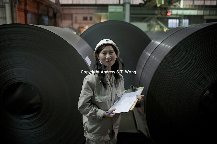 A woman works a factory of Bao Steel in Shanghai, China on November 9, 2009.