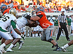 Oklahoma State Cowboys offensive linesman Lane Taylor (68) and Baylor Bears defensive tackle Tracy Robertson (13)  during the game between the Baylor Bears and the Oklahoma State Cowboys at the Boone Pickens Stadium in Stillwater, OK. Oklahoma State defeats Baylor 59 to 24.