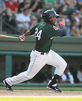 Outfielder Brandon Jacobs (24) of the Greenville Drive, Class A affiliate of the Boston Red Sox, in a game against the Augusta GreenJackets on April 10, 2011, at Fluor Field at the West End in Greenville, South Carolina. (Tom Priddy / Four Seam Images)