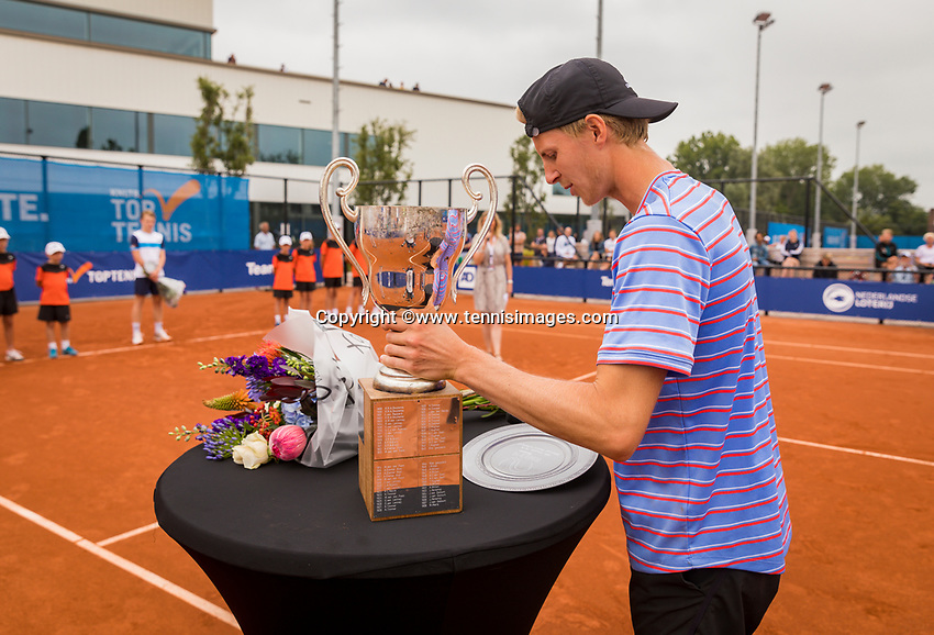 Amstelveen, Netherlands, 1 August 2020, NTC, National Tennis Center, National Tennis Championships, Men's final: winner  Gijs Brouwer (NED) picks up his trophy himself due to Corona messures.<br /> Photo: Henk Koster/tennisimages.com