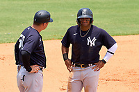 FCL Yankees manager Tyson Blaser (50) talks with Jasson Dominguez (25) during a game against the FCL Tigers on June 28, 2021 at Tigertown in Lakeland, Florida.  (Mike Janes/Four Seam Images)
