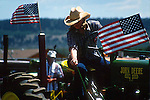YOUNG WOMAN ON TRACTOR AT PARK COUNTY FAIR