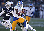 San Jose State's Hansell Wilson (87) runs against Nevada defenders Kendall Johnson (26) and Dameon Baber (23) during the second half of an NCAA college football game in Reno, Nev., on Saturday, Nov. 14, 2015. (AP Photo/Cathleen Allison)