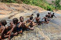 MALAWI, Thyolo, village Matchuwana, children slide on rock spring / MALAWI, Thyolo, Dorf Matchuwana, Kinder rutschen auf einer Wasserbahn auf einem Felsen