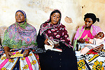 Women at a local meeting of Yehu micro-finance in Kenya.  Yehu is a microfinance organization in the rural coastal region of Kenya for the poor, run by the poor. It provides financial and other support services for small businesses owned by very poor people.