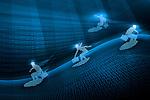 Four businessmen surfing online