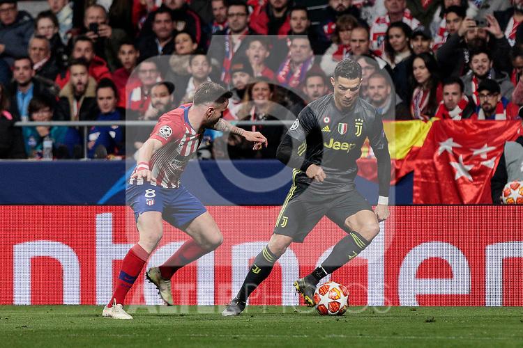 Atletico de Madrid's Saul Niguez and Juventus' Cristiano Ronaldo during UEFA Champions League match, Round of 16, 1st leg between Atletico de Madrid and Juventus at Wanda Metropolitano Stadium in Madrid, Spain. February 20, 2019. (ALTERPHOTOS/A. Perez Meca)