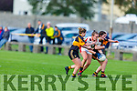 Rathmore's Danelle Leary been well marked by Karina Slattery and Sarah Fitzgerald of  Austin Stacks in the Kerry LGFA Championship Football Semi Final
