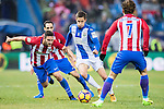 Alexander Szymanowski (c) of Deportivo Leganes battles for the ball with Jorge Resurreccion Merodio Koke (l) of Atletico de Madrid during their La Liga match between Atletico de Madrid and Deportivo Leganes at the Vicente Calderón Stadium on 04 February 2017 in Madrid, Spain. Photo by Diego Gonzalez Souto / Power Sport Images