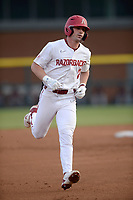 Arkansas right fielder Cayden Wallace rounds the bases Tuesday, April 6, 2021, after hitting a solo home run during the first inning of play against UALR at Baum-Walker Stadium in Fayetteville. Visit nwaonline.com/210407Daily/ for today's photo gallery. <br /> (NWA Democrat-Gazette/Andy Shupe)