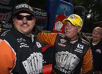 May 11, 2013; Commerce, GA, USA: NHRA funny car driver Johnny Gray celebrates with crew members after winning the Southern Nationals at Atlanta Dragway. Mandatory Credit: Mark J. Rebilas-