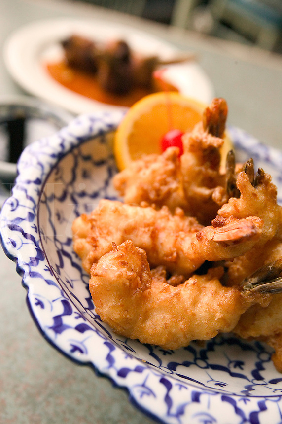 Coconut Battered Shrimp served on a blue and white plate