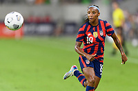 AUSTIN, TX - JUNE 16: Crystal Dunn #19 of the United States chases after a loose ball during a game between Nigeria and USWNT at Q2 Stadium on June 16, 2021 in Austin, Texas.