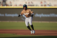 Luisangel Acuna (2) of the Down East Wood Ducks takes his lead off of first base against the Kannapolis Cannon Ballers at Atrium Health Ballpark on May 8, 2021 in Kannapolis, North Carolina. (Brian Westerholt/Four Seam Images)