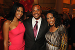 From left: Ursaline Hamilton, Rick Smith and Tiffany Smith at the Children's Museum Gala Saturday Oct. 16, 2010. (Dave Rossman/For the Chronicle)