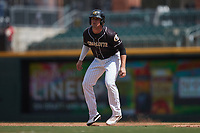 Blake Rutherford (6) of the Charlotte Knights takes his lead off of first base against the Durham Bulls at Truist Field on August 28, 2021 in Charlotte, North Carolina. (Brian Westerholt/Four Seam Images)
