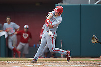 Patrick Bailey (5) of the North Carolina State Wolfpack connects for his second home run of the day against the ne\ at Doak Field at Dail Park on June 2, 2018 in Raleigh, North Carolina. The Wolfpack defeated the Huskies 9-2. (Brian Westerholt/Four Seam Images)