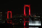 """The Rainbow Bridge is lit up in red, after the Tokyo Metropolitan Government has issued a """"Tokyo alert"""" due to an increase in coronavirus cases in Tokyo, Japan on June 2, 2020. (Photo by Hiroyuki Ozawa/AFLO)"""