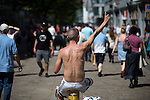 © Joel Goodman - 07973 332324 . 19/07/2016 . Manchester , UK . A man waves his hand in the air along to a busker on Market Street . Sunshine in Manchester City Centre on the hottest day of the year so far . Photo credit : Joel Goodman