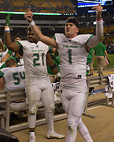 Marshall football players Anthony Anderson and Chase Litton rile up the crowd. The Pitt Panthers defeated the Marshall Thundering Herd 43-27 on October 1, 2016 at Heinz Field in Pittsburgh, Pennsylvania.