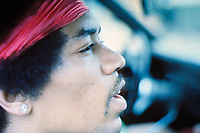 """BNPS.co.uk (01202 558833)<br /> Pic: BarryLevine/Guernseys/BNPS<br /> <br /> !!!ONE TIME USE ONLY!!! PICS ONLY TO BE USED IN RELATION TO THE AUCTION!!!<br /> <br /> Pictured: Jimi Hendrix in a car.<br /> <br /> A photo collection offering a rare glimpse of the iconic Woodstock Festival has sold for over £12,000.<br /> <br /> The unique Levine series captured some of the world's most famous rock stars performing at the one-of-a-kind festival in Bethel, New York, in August 1969, including Jimi Hendrix, Janis Joplin, The Who, and Neil Young.<br /> <br /> Barry Levine, now 77, brushed shoulders with many of his subjects, recalling Hendrix's """"amazing sense of humour"""" and Young's disdain for photographers from his home in Florida."""